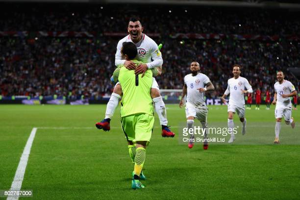 Claudio Bravo of Chile celebrates with his team mates after the penalty shoot out during the FIFA Confederations Cup Russia 2017 SemiFinal between...