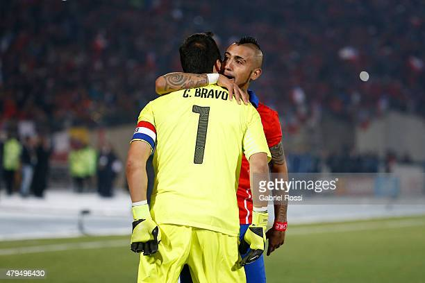 Claudio Bravo of Chile celebrates with teammate Arturo Vidal after winning the 2015 Copa America Chile Final match between Chile and Argentina at...