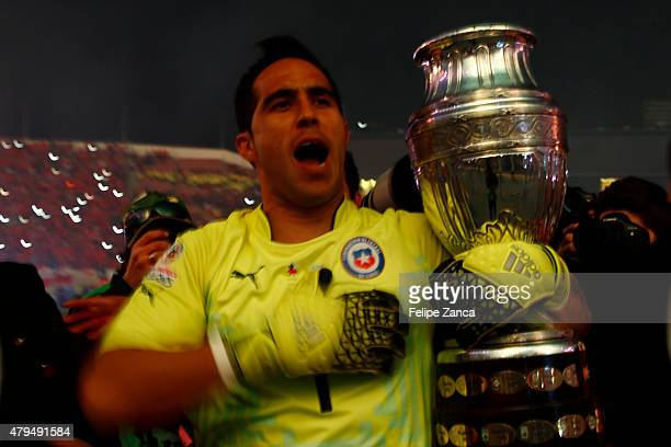 Claudio Bravo of Chile celebrates with the trophy after winning the 2015 Copa America Chile Final match between Chile and Argentina at Nacional...
