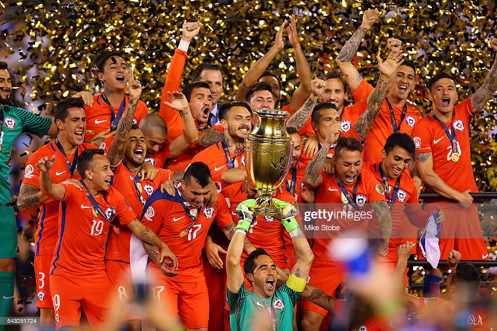 Claudio Bravo of Chile hoist the trophy after defeating Argentina to win the Copa America Centenario Championship match at MetLife Stadium on June 26...
