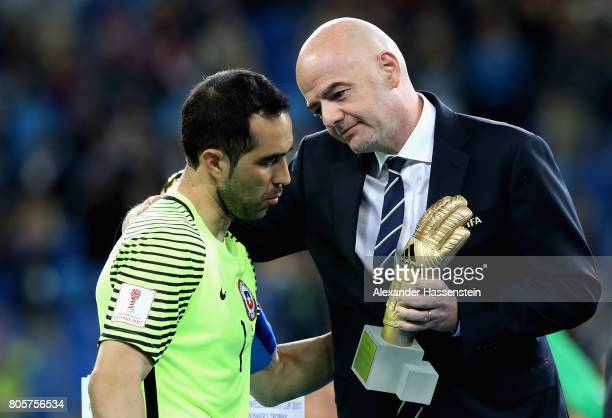 Claudio Bravo of Chile is awarded the golden glove by Gianni Infantino FIFA pesident after the FIFA Confederations Cup Russia 2017 Final between...