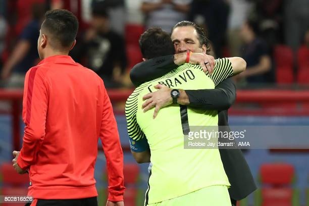 Claudio Bravo of Chile is embraced by Chile Head Coach / Manager Juan Antonio Pizzi after winning a penalty shootout during the FIFA Confederations...