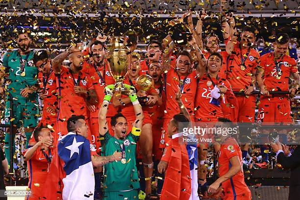 Claudio Bravo of Chile lifts the trophy after winning the championship match between Argentina and Chile at MetLife Stadium as part of Copa America...