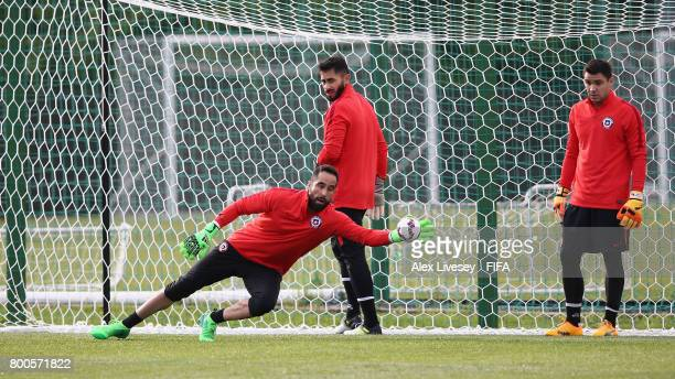 Claudio Bravo of Chile makes a save while Johnny Herrera looks on during a training session at the Strogino Training Ground during the FIFA...