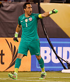 Claudio Bravo of Chile reacts to making the save on Lucas Biglia of Argentina during the penalty shootout in the championship match between Argentina...