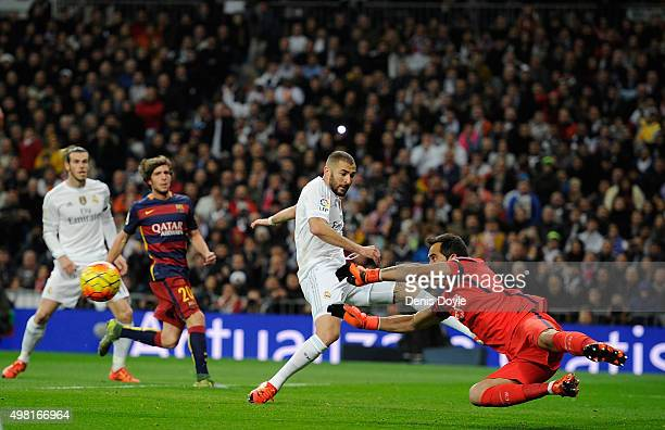 Claudio Bravo of FC Barcelona saves from Karim Benzema of Real Madrid during the La Liga match between Real Madrid and Barcelona at Estadio Santiago...
