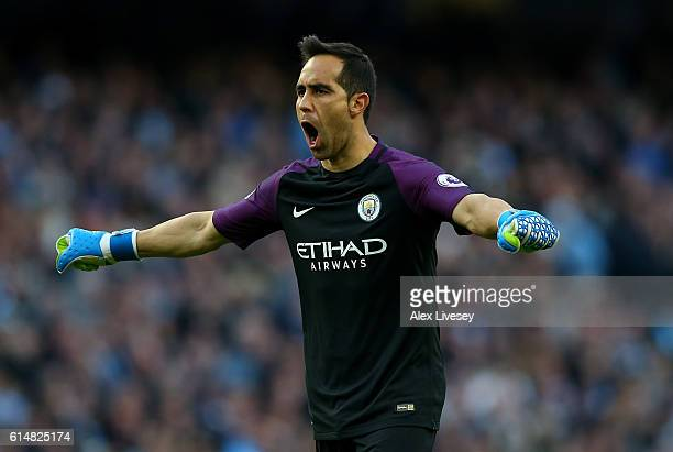 Claudio Bravo of Manchester City celebrates his team scoring during the Premier League match between Manchester City and Everton at Etihad Stadium on...