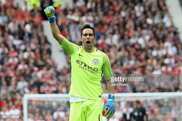Claudio Bravo of Manchester City celebrates his team's first goal during the Premier League match between Manchester United and Manchester City at...