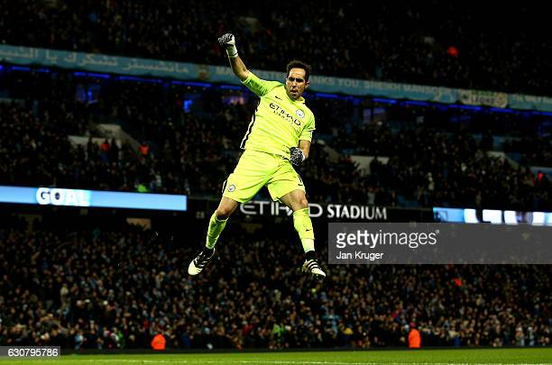 Claudio Bravo of Manchester City celebrates the goal scored by Sergio Aguero of Manchester City during the Premier League match between Manchester...