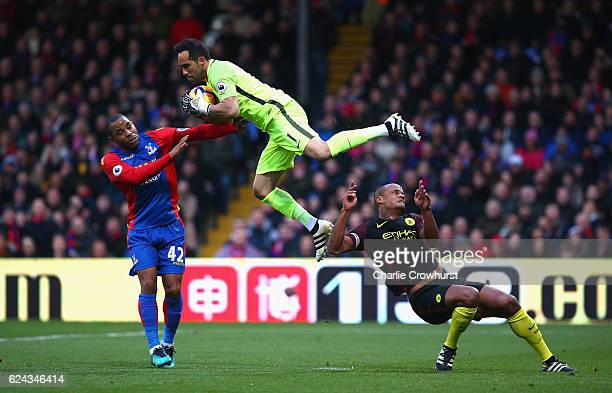Claudio Bravo of Manchester City collects the ball while under pressure from Jason Puncheon of Crystal Palace during the Premier League match between...