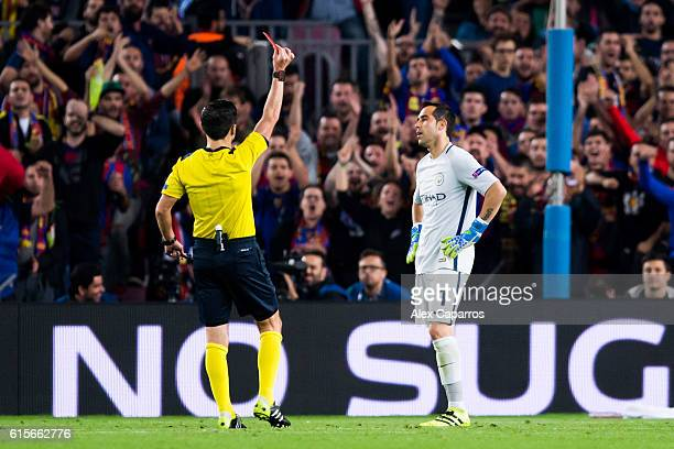 Claudio Bravo of Manchester City FC is shown a red card during the UEFA Champions League group C match between FC Barcelona and Manchester City FC at...