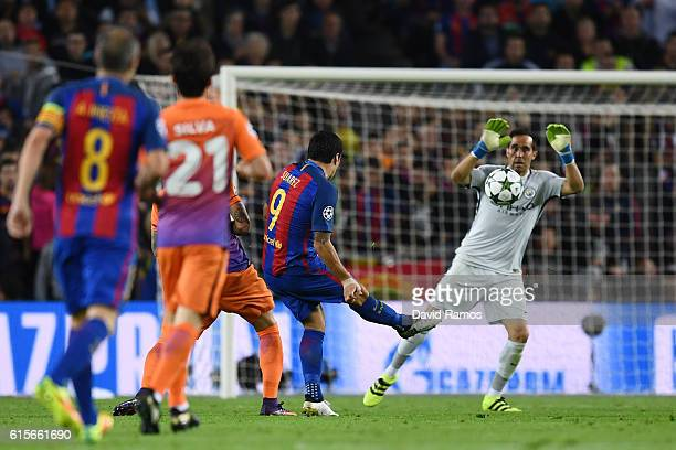 Claudio Bravo of Manchester City handles the shot from Luis Suarez of Barcelona outside of his area during the UEFA Champions League group C match...