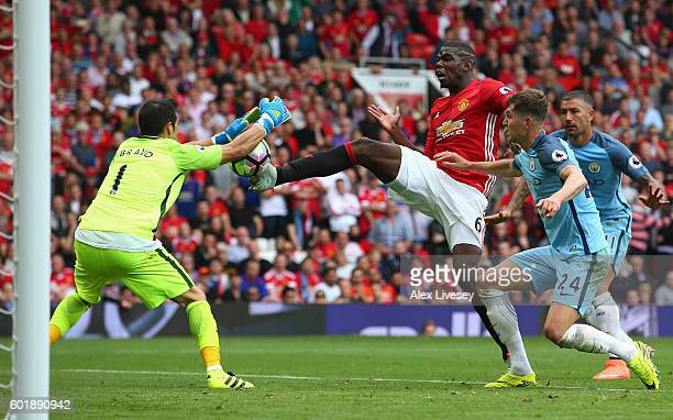 Claudio Bravo of Manchester City makes a save from Paul Pogba of Manchester United during the Premier League match between Manchester United and...