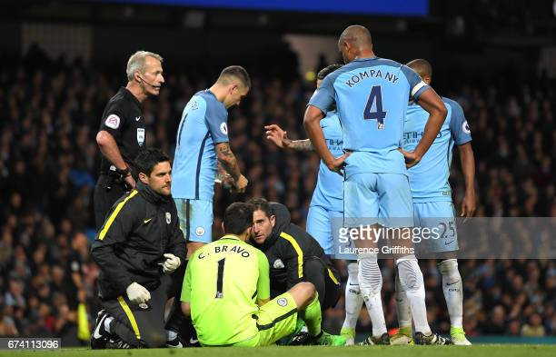 Claudio Bravo of Manchester City recieves treatment prior to being stretchered off due to an injury during the Premier League match between...