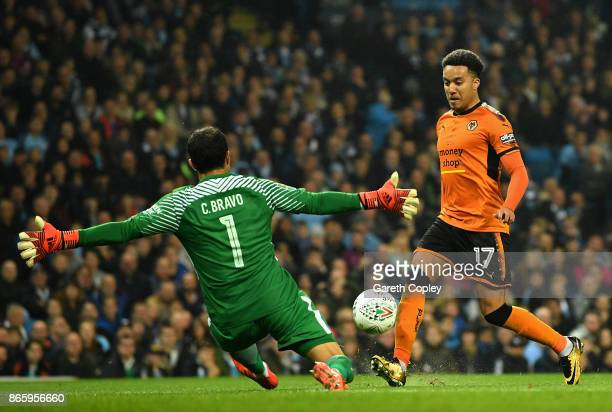 Claudio Bravo of Manchester City saves a shot from Helder Costa of Wolverhampton Wanderers during the Carabao Cup Fourth Round match between...