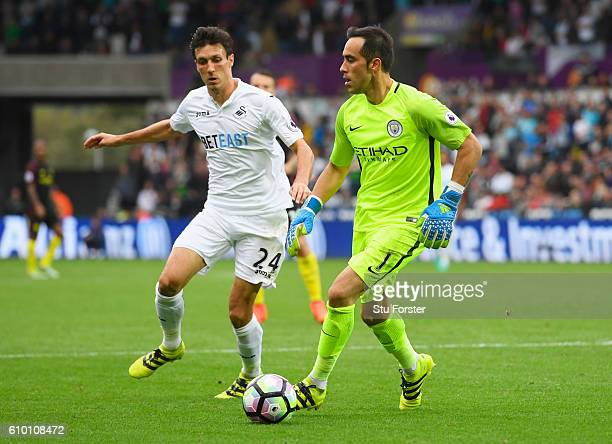 Claudio Bravo of Manchester City takes on Jack Cork of Swansea City during the Premier League match between Swansea City and Manchester City at the...