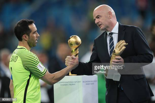 Claudio Bravo of the Chile national football team and President of FIFA Gianni Infantino during the 2017 FIFA Confederations Cup final match between...