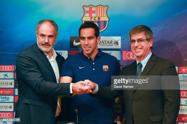 Claudio Bravo poses with the FC Barcelona Sport director Andoni Zubizarreta and FC Barcelona VicePresident Jordi Mestre as a new player for FC...