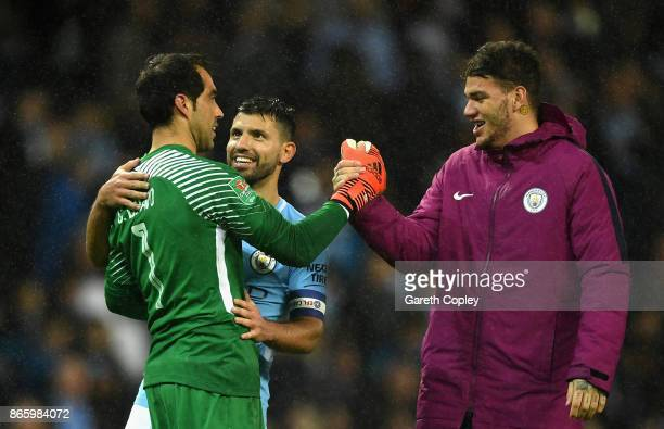 Claudio Bravo Sergio Aguero and Ederson of Manchester City celebrate their win during the Carabao Cup Fourth Round match between Manchester City and...