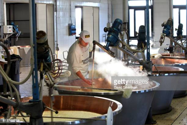 Claudio Censi owner and head cheesemaker at his family caseificio or dairy makes ParmigianoReggiano cheese in the traditional method on March 26 2017...