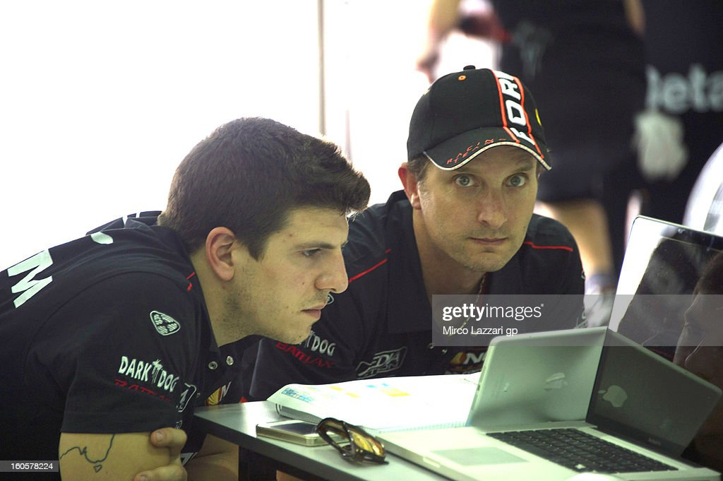Claudio Corti of Italy and NGM Mobile Forward Racing (L) and Colin Edwards of USA and NGM Mobile Forward Racing look at laptop screens during day one of CRT Tests for the MotoGP at Sepang Circuit on February 3, 2013 in Kuala Lumpur, Malaysia.