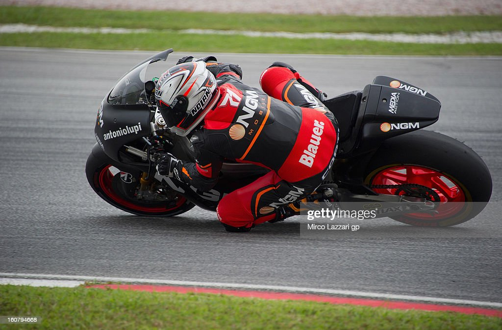 Claudio Corti of Italy and NGM Mobile Forward Racing rounds the bend during the MotoGP Tests in Sepang - Day Four at Sepang Circuit on February 6, 2013 in Kuala Lumpur, Malaysia.