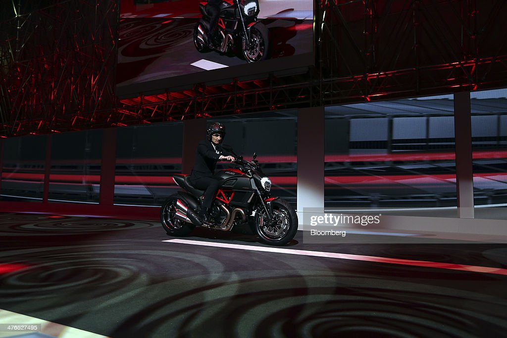 Claudio Domenicali chief executive officer of Ducati Motor Holding SpA a unit of Audi AG arrives on stage on a Ducat Diavel motorbike during a news...