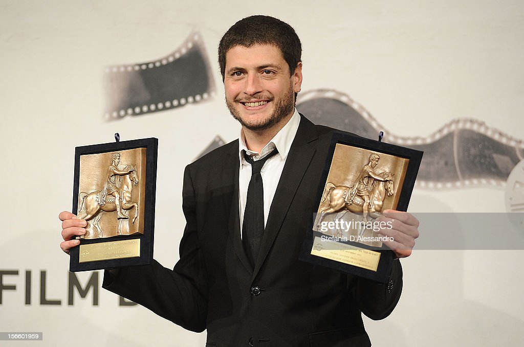 Claudio Giovannesi poses with his Special Mention during the Award Winners Photocall on November 17, 2012 in Rome, Italy.