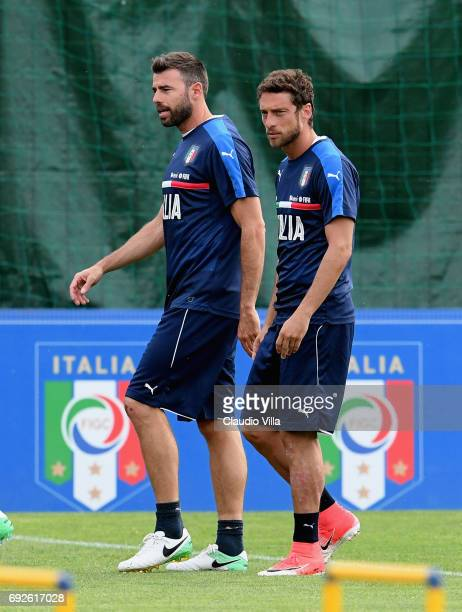 Claudio Marchisio and Andrea Barzagli of Italy in action during the training session at Coverciano on June 05 2017 in Florence Italy