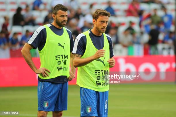 Claudio Marchisio and Andrea Barzagli of Italy warm up before the international friendly between Italy and Uruguay at Allianz Riviera stadium on June...