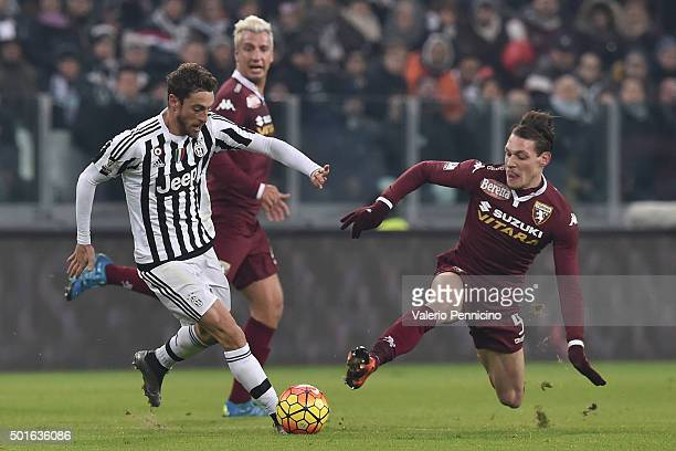 Claudio Marchisio of FC Juventus is tackled by Andrea Belotti of Torino FC during the TIM Cup match between FC Juventus and Torino FC at Juventus...
