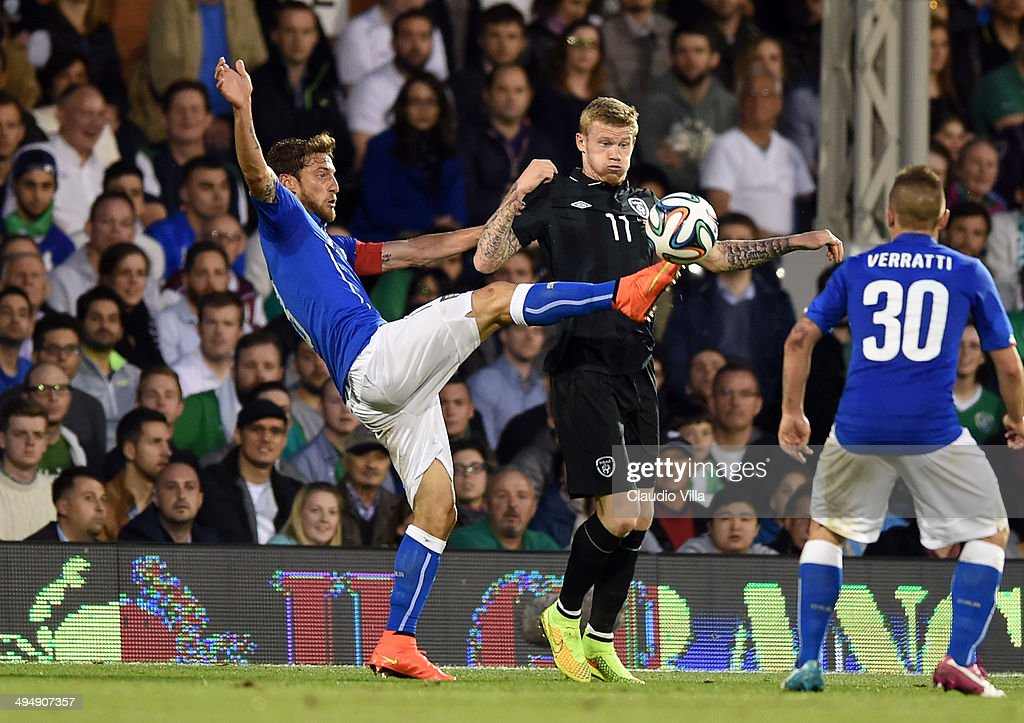 Claudio Marchisio of Italy and James McClean of Ireland #11 compete for the ball during the International Friendly match between Italy and Ireland at Craven Cottage on May 30, 2014 in London, England.