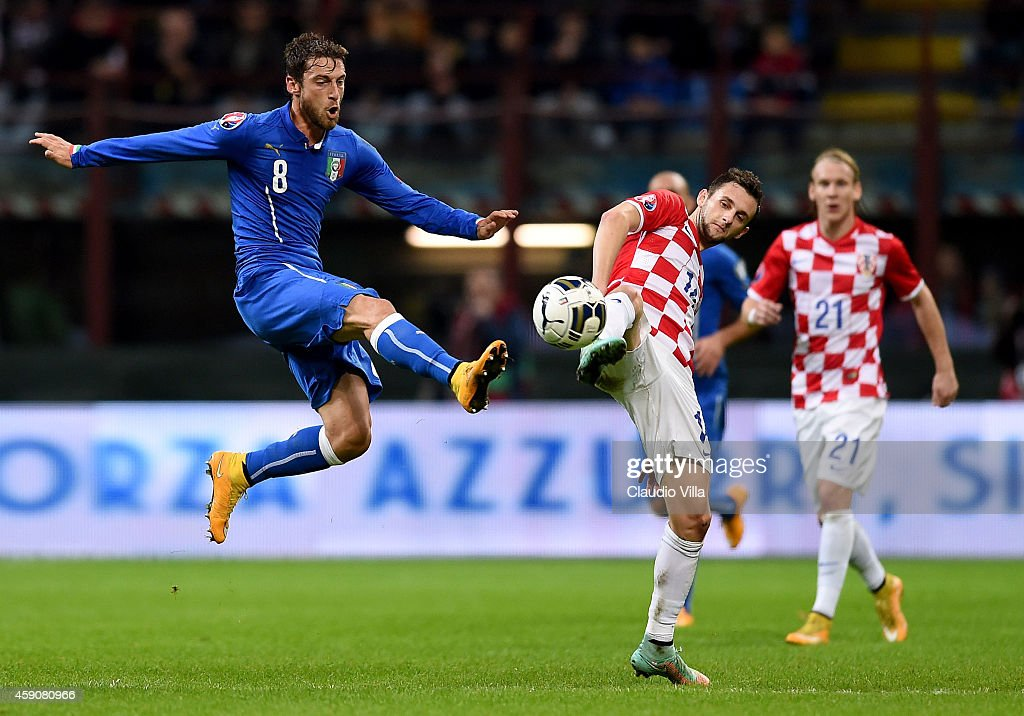 <a gi-track='captionPersonalityLinkClicked' href=/galleries/search?phrase=Claudio+Marchisio&family=editorial&specificpeople=4604252 ng-click='$event.stopPropagation()'>Claudio Marchisio</a> of Italy #8 and Marcelo Brozovic of Croatia compete for the ball during the EURO 2016 Group H Qualifier match between Italy and Croatia at Stadio Giuseppe Meazza on November 16, 2014 in Milan, Italy.