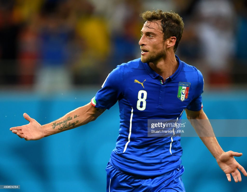 <a gi-track='captionPersonalityLinkClicked' href=/galleries/search?phrase=Claudio+Marchisio&family=editorial&specificpeople=4604252 ng-click='$event.stopPropagation()'>Claudio Marchisio</a> of Italy celebrates after scoring the team's first goal during the 2014 FIFA World Cup Brazil Group D match between England and Italy at Arena Amazonia on June 14, 2014 in Manaus, Brazil.