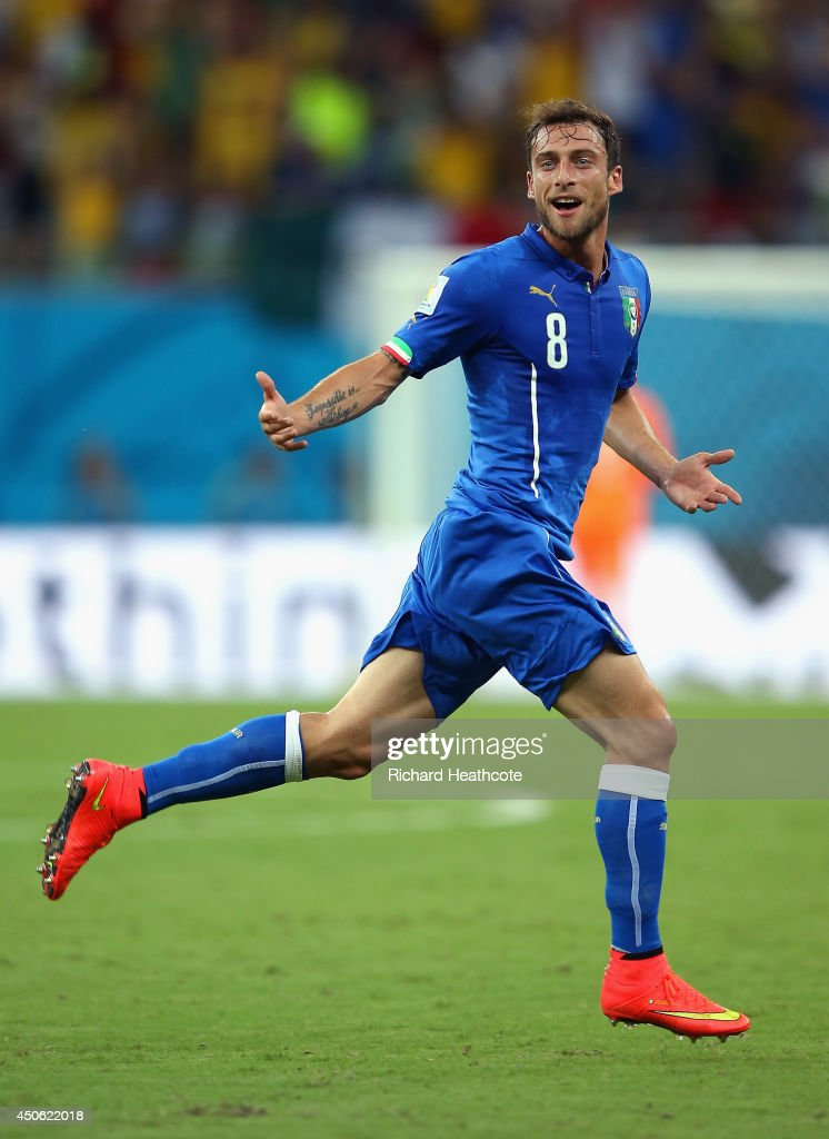 <a gi-track='captionPersonalityLinkClicked' href=/galleries/search?phrase=Claudio+Marchisio&family=editorial&specificpeople=4604252 ng-click='$event.stopPropagation()'>Claudio Marchisio</a> of Italy celebrates scoring his team's first goal during the 2014 FIFA World Cup Brazil Group D match between England and Italy at Arena Amazonia on June 14, 2014 in Manaus, Brazil.