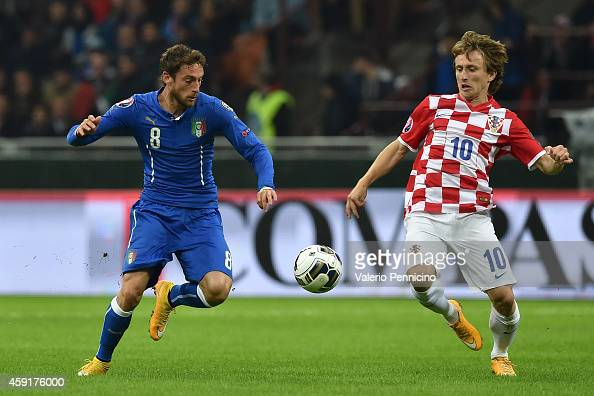 Claudio Marchisio of Italy competes with Luka Modric of Croatia during the EURO 2016 Group H Qualifier match between Italy and Croatia at Stadio...