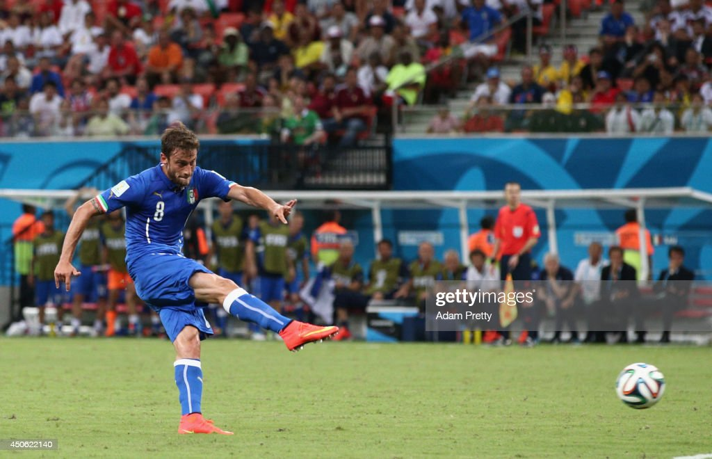 <a gi-track='captionPersonalityLinkClicked' href=/galleries/search?phrase=Claudio+Marchisio&family=editorial&specificpeople=4604252 ng-click='$event.stopPropagation()'>Claudio Marchisio</a> of Italy shoots and scores his team's first goal during the 2014 FIFA World Cup Brazil Group D match between England and Italy at Arena Amazonia on June 14, 2014 in Manaus, Brazil.