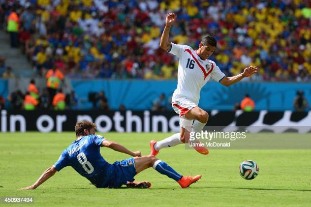 Claudio Marchisio of Italy tackles Cristian Gamboa of Costa Rica during the 2014 FIFA World Cup Brazil Group D match between Italy and Costa Rica at...