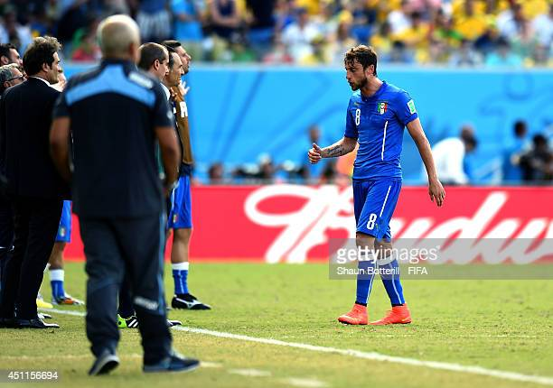 Claudio Marchisio of Italy walks off the pitch after being sent off with a straight red card during the 2014 FIFA World Cup Brazil Group D match...