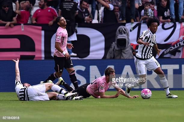 Claudio Marchisio of Juventus and Franco Vazquez of Palermo lie on the pitch after an injury during the Serie A match between Juventus FC and US...