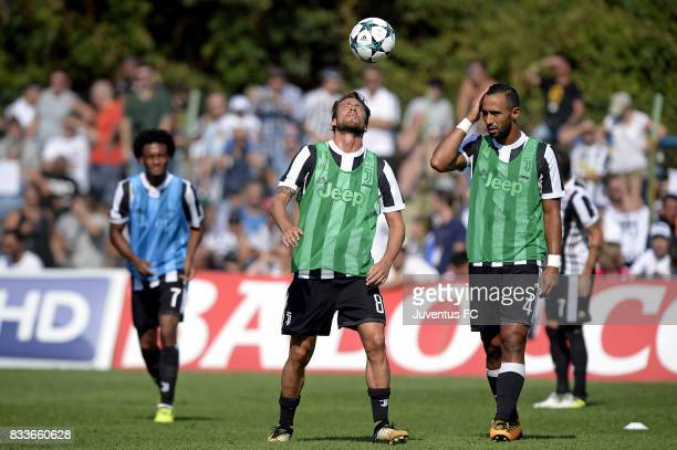 Claudio Marchisio of Juventus and Medhi Benatia warm up before the preseason friendly match between Juventus A and Juventus B on August 17 2017 in...