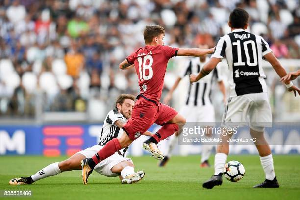 Claudio Marchisio of Juventus and Nicolo' Barella of Cagliari compete for the ball during the Serie A match between Juventus and Cagliari Calcio at...