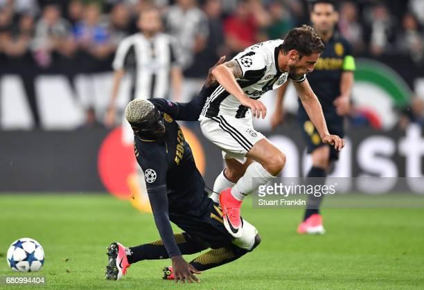 Claudio Marchisio of Juventus and Tiemoue Bakayoko of AS Monaco clash during the second leg match between Juventus and AS Monaco at Juventus Stadium...