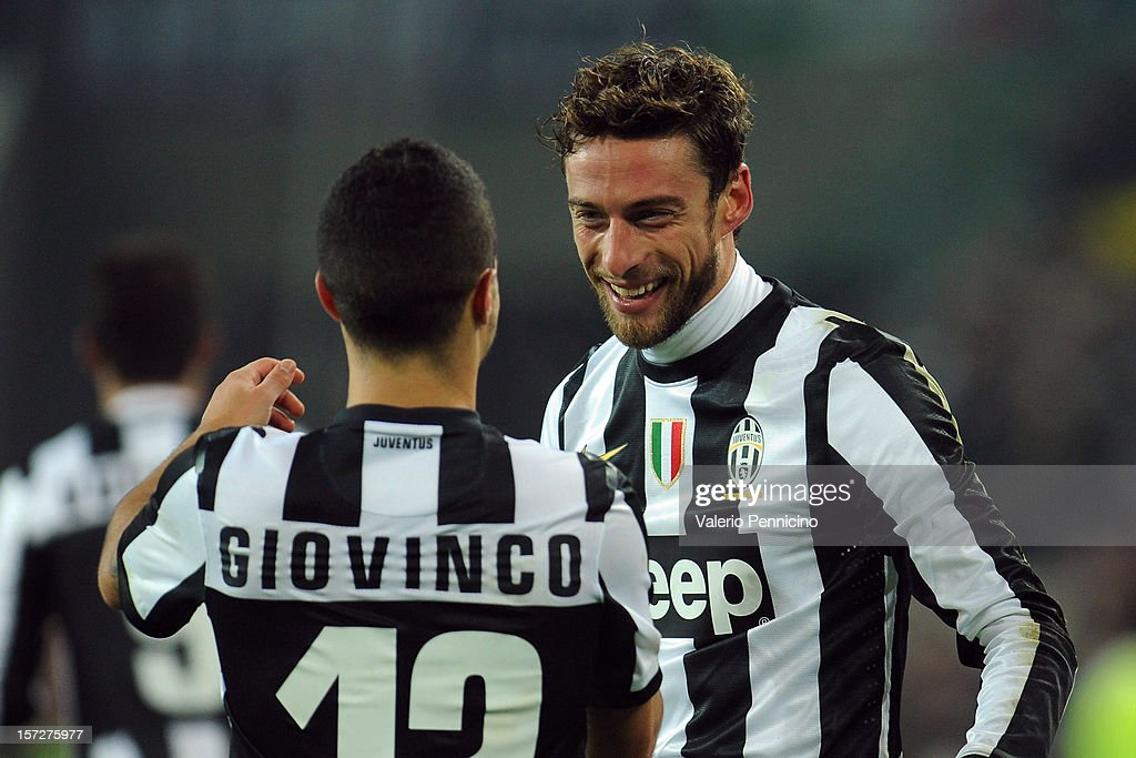Claudio Marchisio (R) of Juventus celebrates his goal with team-mates Sebastian Giovinco during the Serie A match between Juventus and Torino FC at Juventus Arena on December 1, 2012 in Turin, Italy.