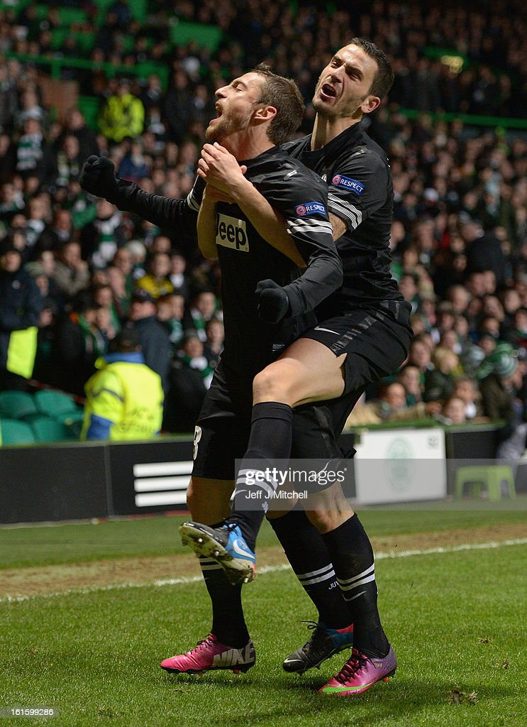 Claudio Marchisio of Juventus celebrates scoring his team's second goal with team-mate Leonardo Bonucci (r) during the UEFA Champions League Round of 16 first leg match between Celtic and Juventus at Celtic Park Stadium on February 12, 2013 in Glasgow, Scotland.