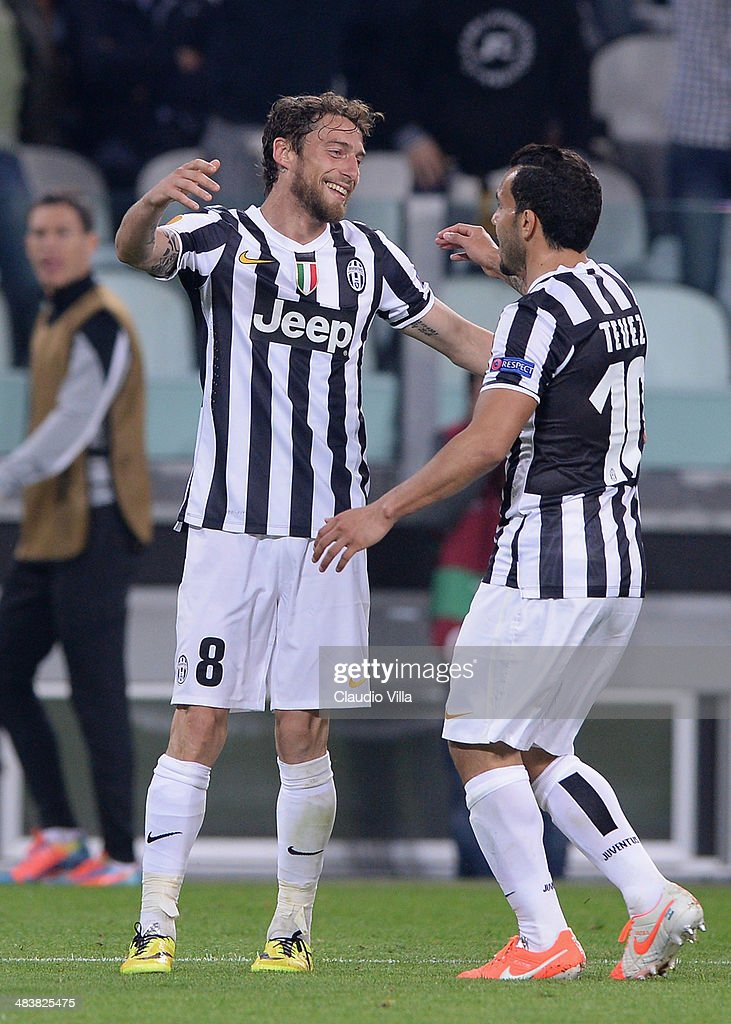 Claudio Marchisio of Juventus (L) celebrates scoring the second goal during the UEFA Europa League quarter final match between Juventus and Olympique Lyonnais at Juventus Arena on April 10, 2014 in Turin, Italy.