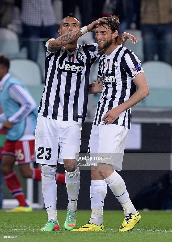 <a gi-track='captionPersonalityLinkClicked' href=/galleries/search?phrase=Claudio+Marchisio&family=editorial&specificpeople=4604252 ng-click='$event.stopPropagation()'>Claudio Marchisio</a> of Juventus (R) celebrates scoring the second goal during the UEFA Europa League quarter final match between Juventus and Olympique Lyonnais at Juventus Arena on April 10, 2014 in Turin, Italy.