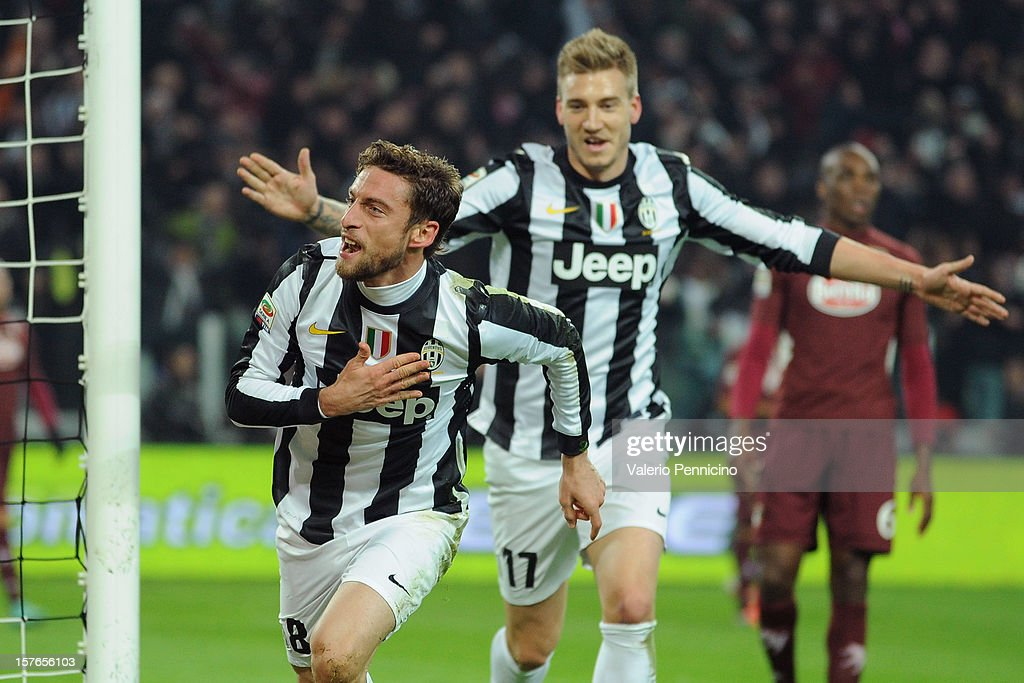 Claudio Marchisio (L) of Juventus celebrates the opening goal during the Serie A match between Juventus and Torino FC at Juventus Arena on December 1, 2012 in Turin, Italy.