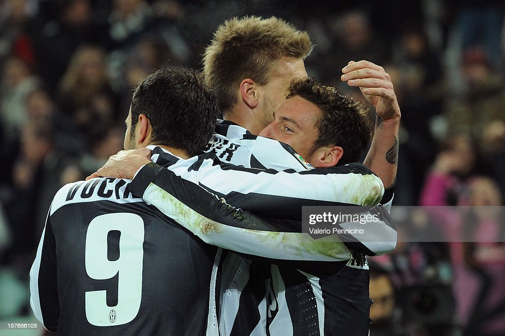 Claudio Marchisio (R) of Juventus celebrates the opening goal with his team-mates during the Serie A match between Juventus and Torino FC at Juventus Arena on December 1, 2012 in Turin, Italy.