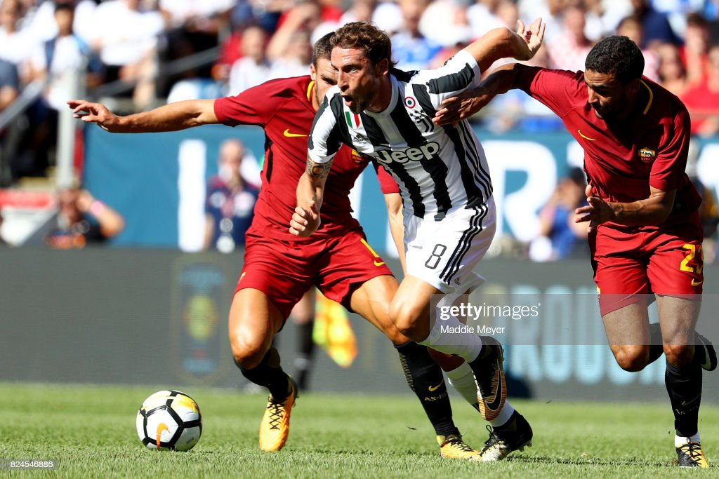 Claudio Marchisio #8 of Juventus dribbles past Gregoire Defrel #23 of Roma during the International Champions Cup 2017 match at Gillette Stadium on July 30, 2017 in Foxboro, Massachusetts.